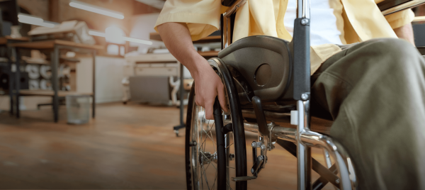 A man in a wheelchair navigates an office environment